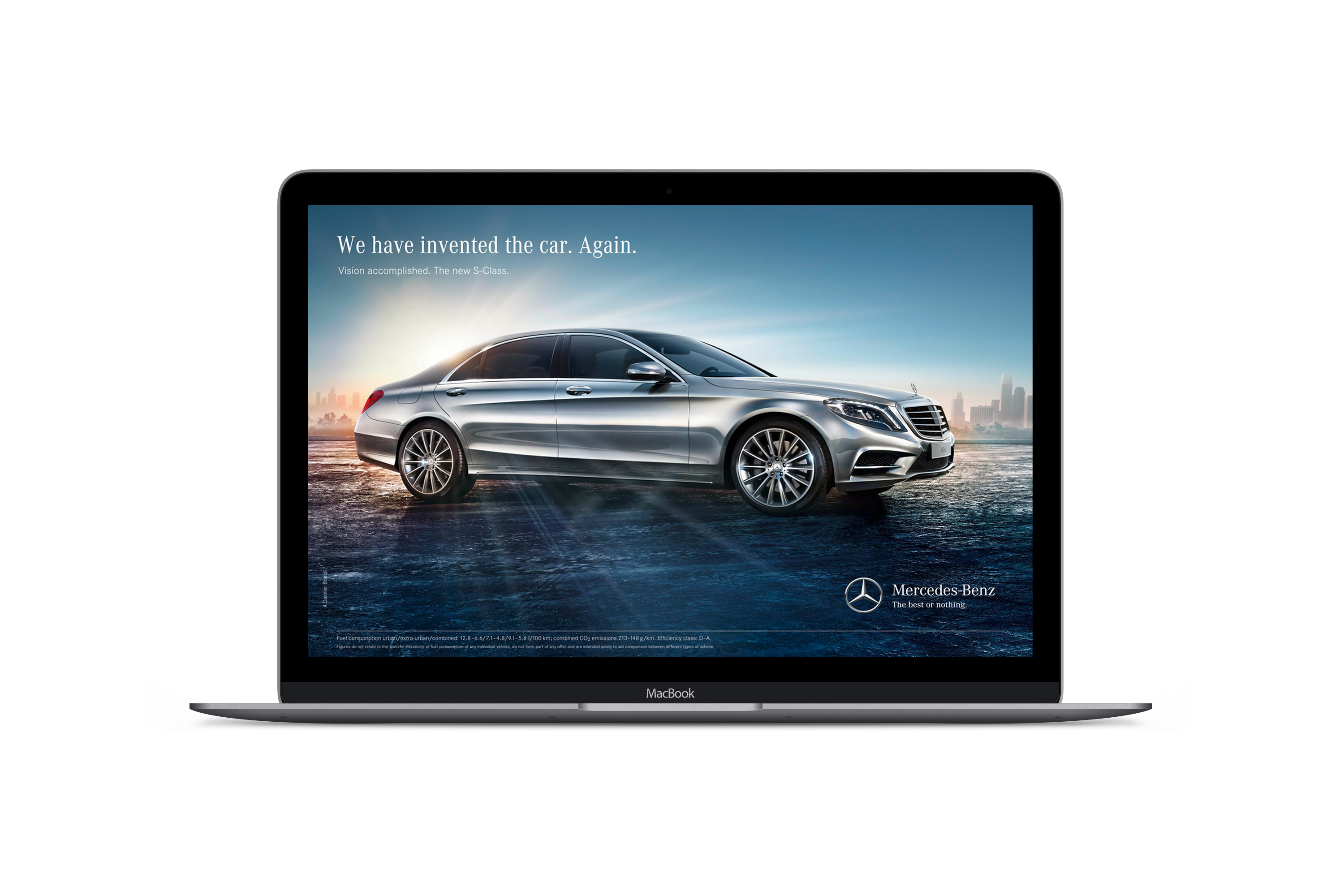 "How to Craft your Buyer Personas Blog. This is an image of a MacBook Pro laptop opened up and displaying an advert for a Mercedes Benz car. In the image is a Mercedes S-Class on a road with the sun shining behind it. The slogan in the sky reads ""We have invented the car again"". The Mercedes caption reads ""All or Nothing"""